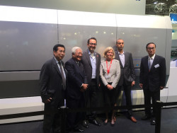 Zarik Megerdichian, CEO of 4over Inc., stands with the Komori team in front of the Impremia NS40.